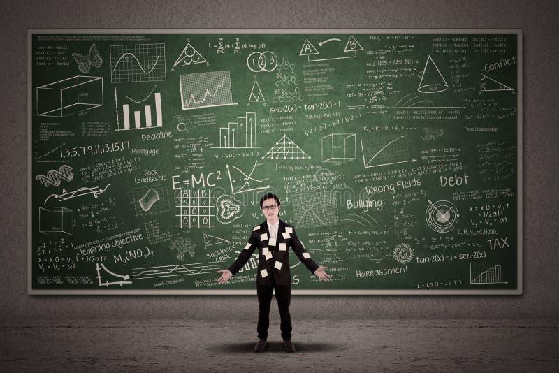Busy businessman with chalkboard