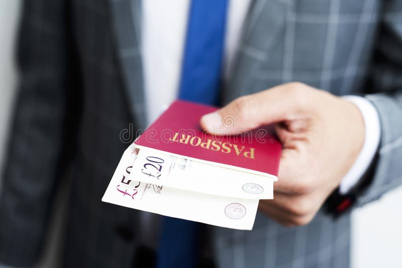 Businessman with pound banknotes in his passport royalty free stock images
