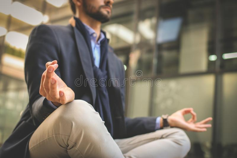 Businessman practicing yoga on the street. royalty free stock photos