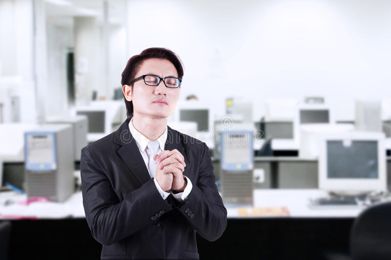 Download Businessman pray at office stock photo. Image of employee - 32978032