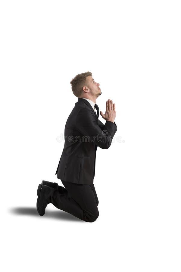 Businessman praying stock photos