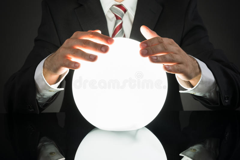 Businessman Predicting Future With Crystal Ball royalty free stock image