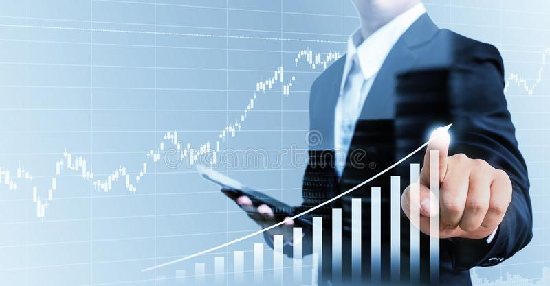 Businessman present financial hand touching graph growing business,Double exposure stock photos