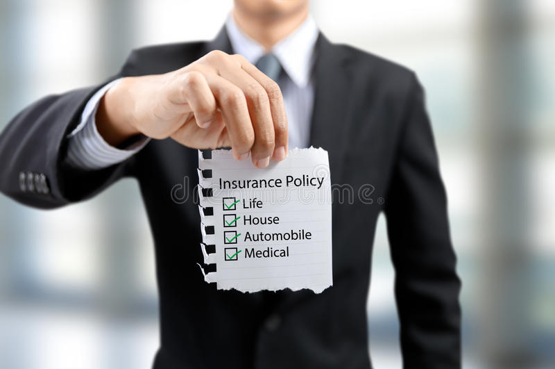 Businessman present insurance policy. With life, house, automobile, medical stock photo