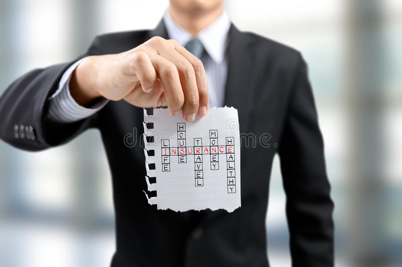 Businessman present a puzzle with insurance concept stock photo