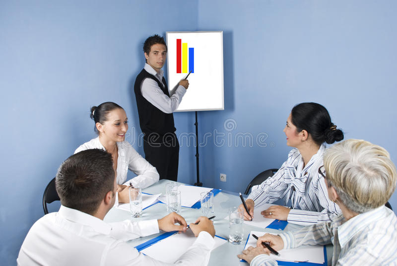 Businessman presentation at business meeting stock photo