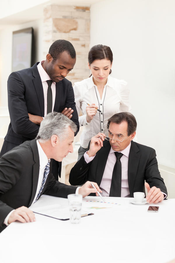 Businessman presenting ideas to his business team royalty free stock image