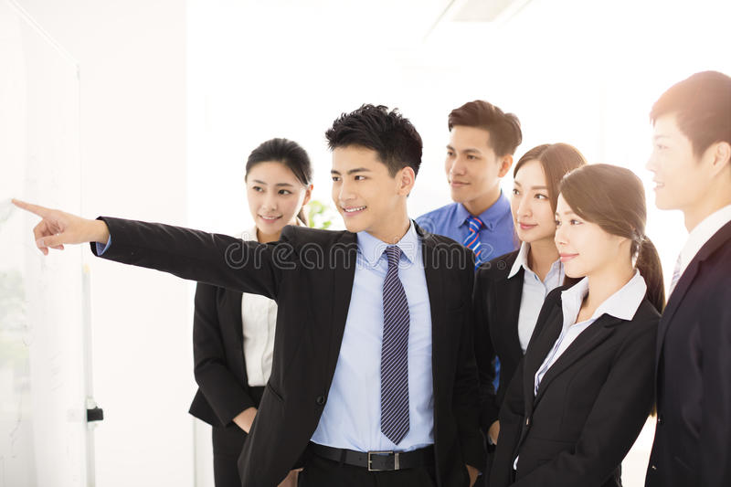 Businessman presenting new project to partners in office stock images