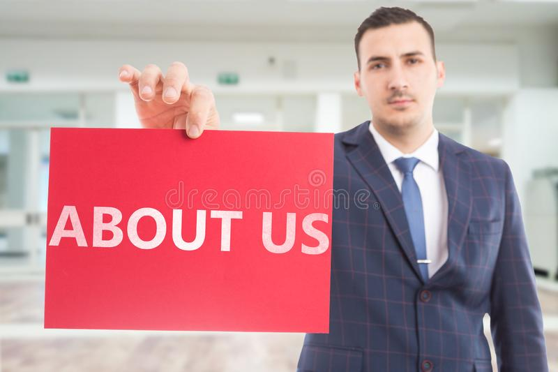 Businessman presenting paper with about us text stock images