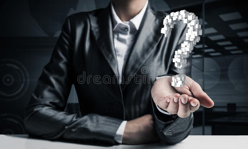 Businessman presenting question mark. Cropped image of businessman in suit presenting multiple cubes in form of question mark in his hand. 3D rendering royalty free stock photography