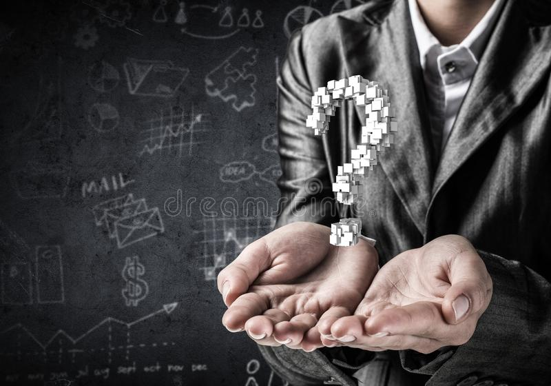 Businessman presenting question mark. Cropped image of businessman in suit presenting multiple cubes in form of question mark in his hands. 3D rendering royalty free stock photos