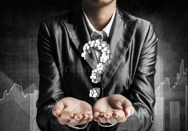 Businessman presenting question mark. Cropped image of businessman in suit presenting multiple cubes in form of question mark in his hands. 3D rendering royalty free stock photography