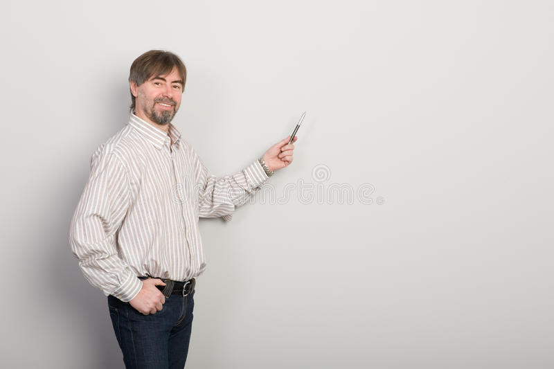 Businessman presenting something royalty free stock photos