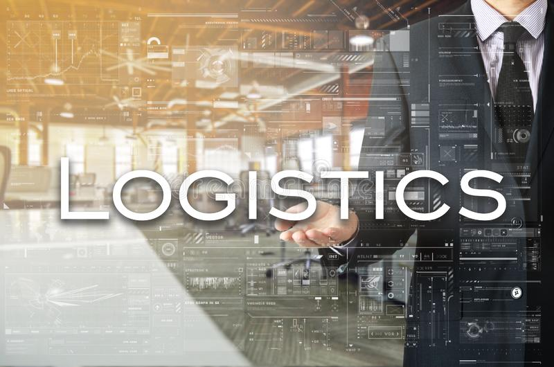 Businessman is presenting text: Logistics. Business concept royalty free stock image