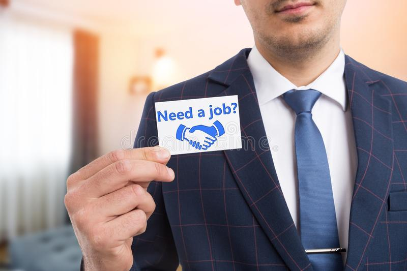 Businessman presenting card with need a job question stock images