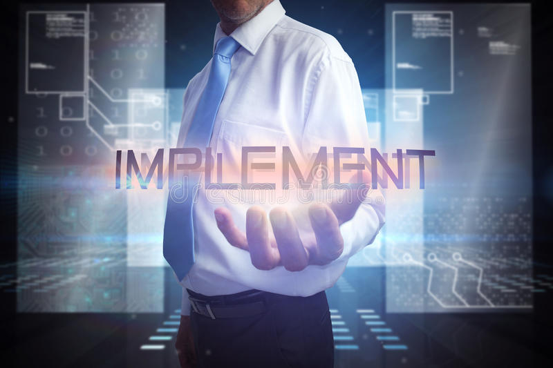 Businessman presenting the word implement. Against hologram on black background with squares royalty free stock photos