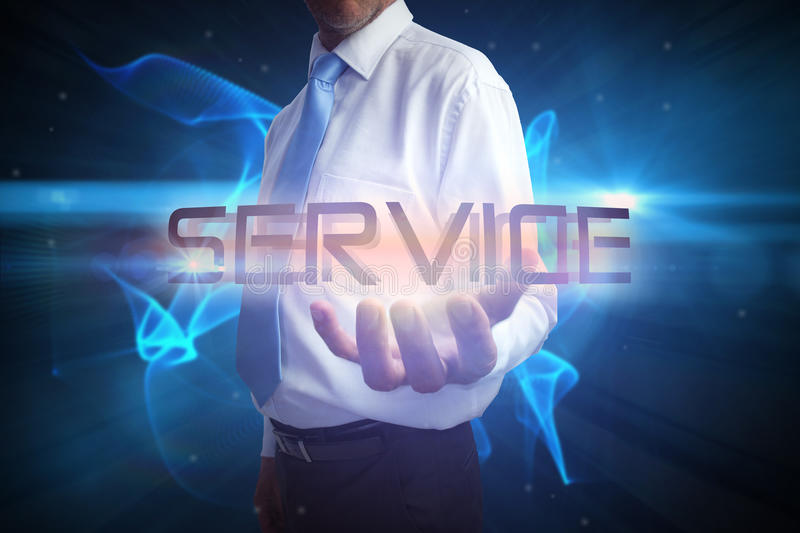 Businessman presenting the word service royalty free stock image