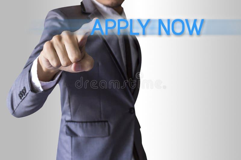 Businessman press text apply now conceptual stock photo
