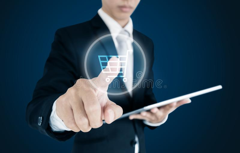 Businessman pressing on cart icon on screen, online shopping, e-commerce e-business stock photography