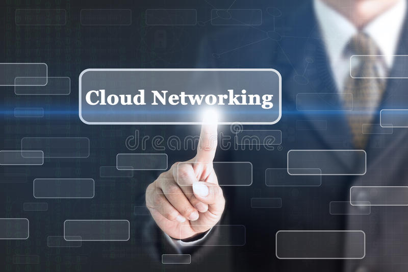 Businessman pressing Cloud Networking concept button. royalty free stock photo