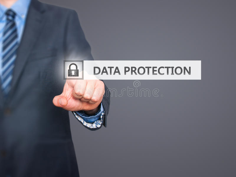 Businessman pressing Data Protection button on virtual screens stock photos