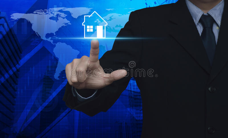 Businessman pressing house icon over map and city tower, Real es. Tate concept, Elements of this image furnished by NASA royalty free stock images