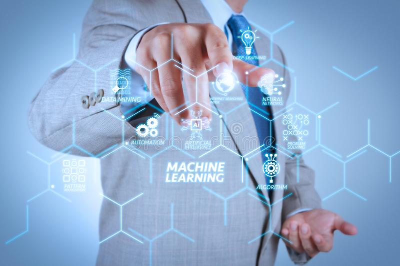Businessman pressing an imaginary button on virtual screen. Machine learning technology diagram with artificial intelligence (AI),neural network,automation,data stock photos