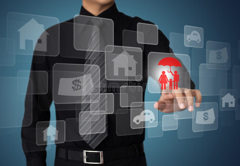 Businessman pressing insurance button stock photography