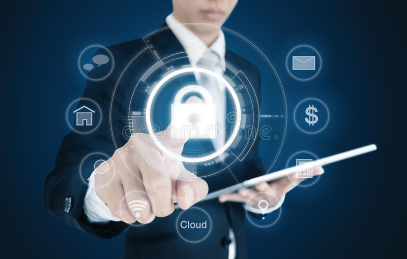 Businessman pressing lock icon on virtual screen. Internet and cyber business security system concept stock image