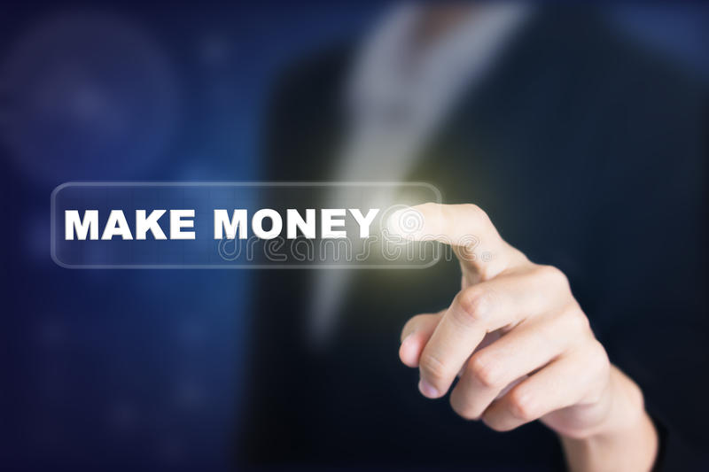 Businessman pressing a MAKE MONEY concept button. stock image
