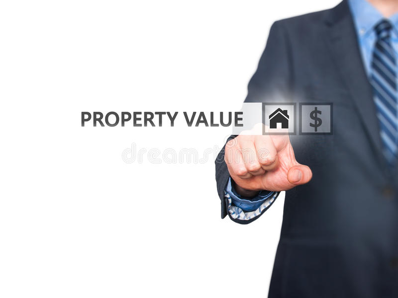 Businessman pressing Property Value button on virtual screens stock images