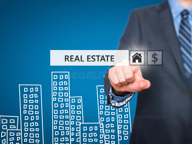 Businessman pressing real estate button on virtual screens. Home and dollar icon. business, technology, internet and networking concept . Isolated on blue royalty free stock photos