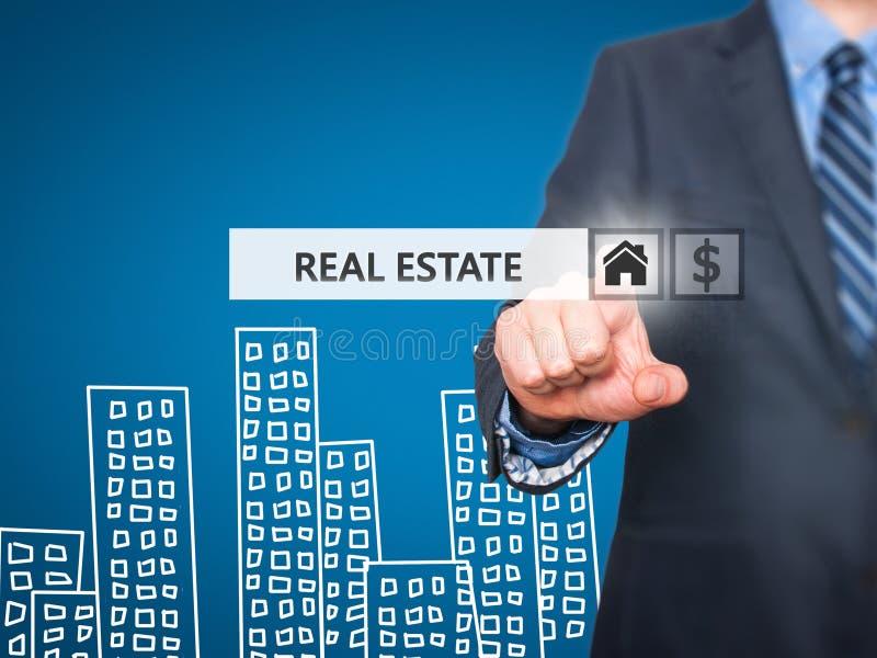 Businessman pressing real estate button on virtual screens royalty free stock photos