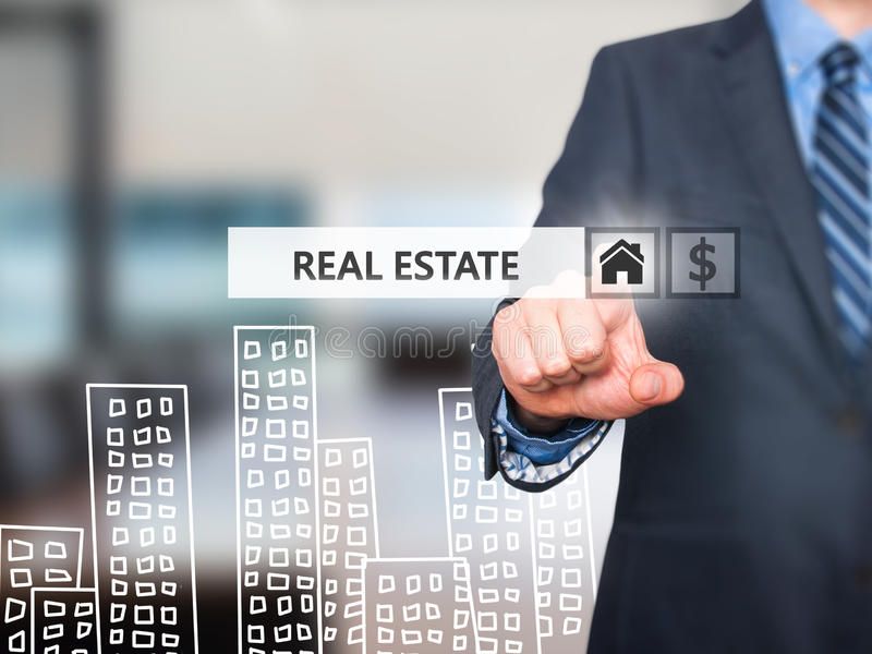 Businessman pressing real estate button on virtual screens. Home and dollar icon. business, technology, internet and networking concept . Isolated on office royalty free stock photography