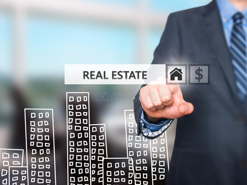 Businessman pressing real estate button on virtual screens. Home and dollar icon. business, technology, internet and networking concept . Isolated on office stock images