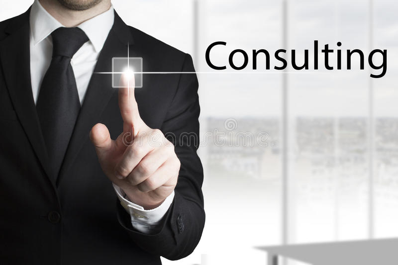 Businessman pressing touchscreen button consulting stock photos