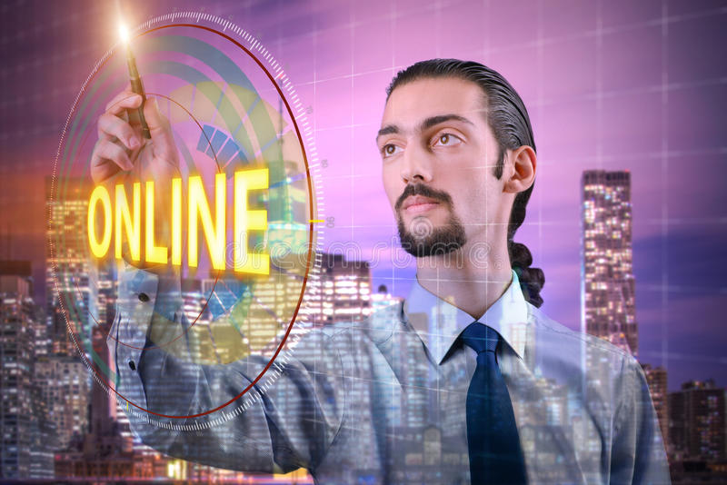 The businessman pressing virtual button online. Businessman pressing virtual button online royalty free stock image