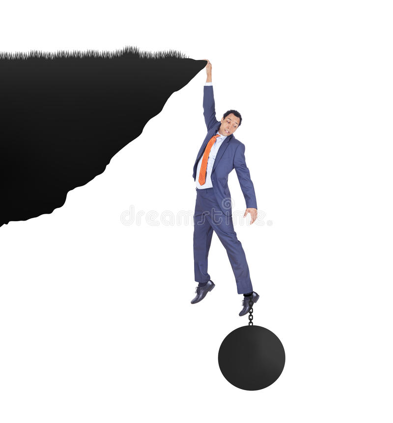 Businessman pressured by heavy metal ball stock photography