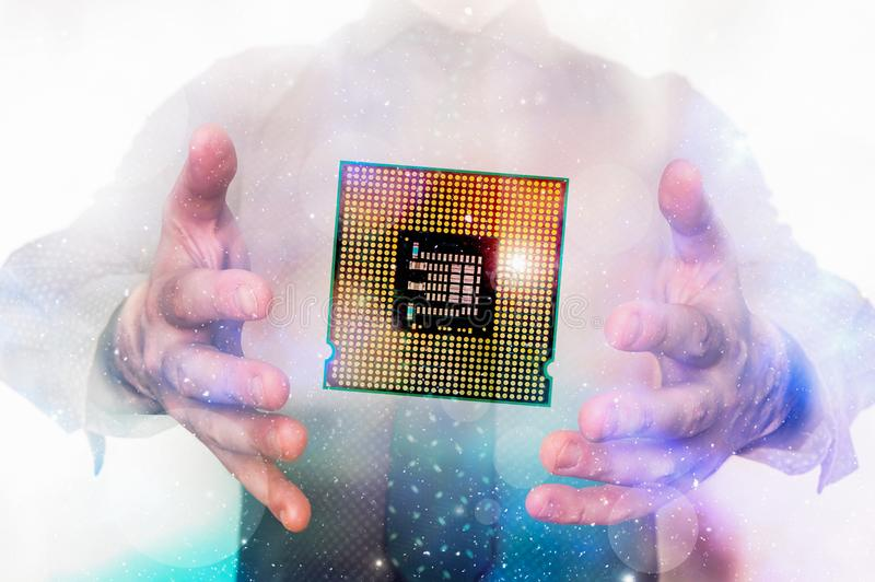 Businessman with processor microchip between his hands stock images