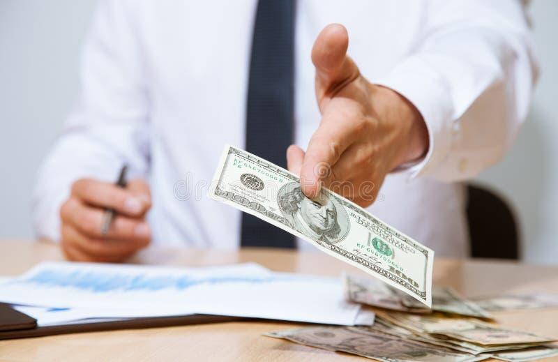 Businessman proposing money to you. Closeup shot stock photos