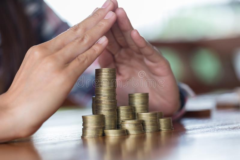 Businessman Protecting Coins. Financial safety Concept. stock images
