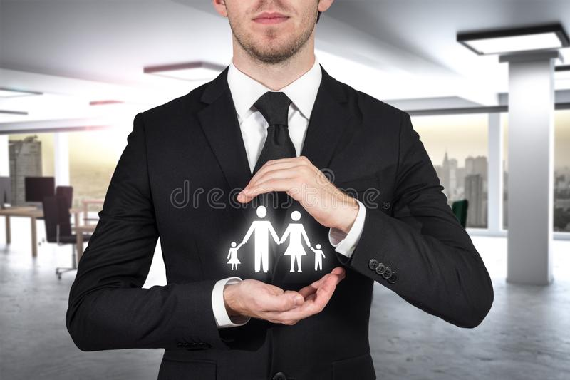 Businessman protecting family paper cut with hands 3D Illustration stock photos