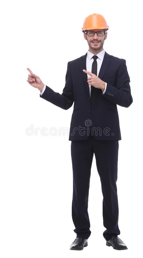 Businessman in protective helmet holding out his hand for a handshake. In full growth. businessman in protective helmet holding out his hand for a handshake stock photography