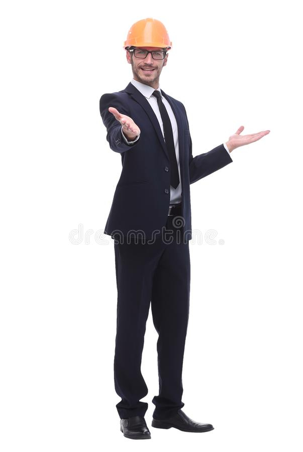Businessman in protective helmet holding out his hand for a handshake. In full growth. businessman in protective helmet holding out his hand for a handshake stock photo