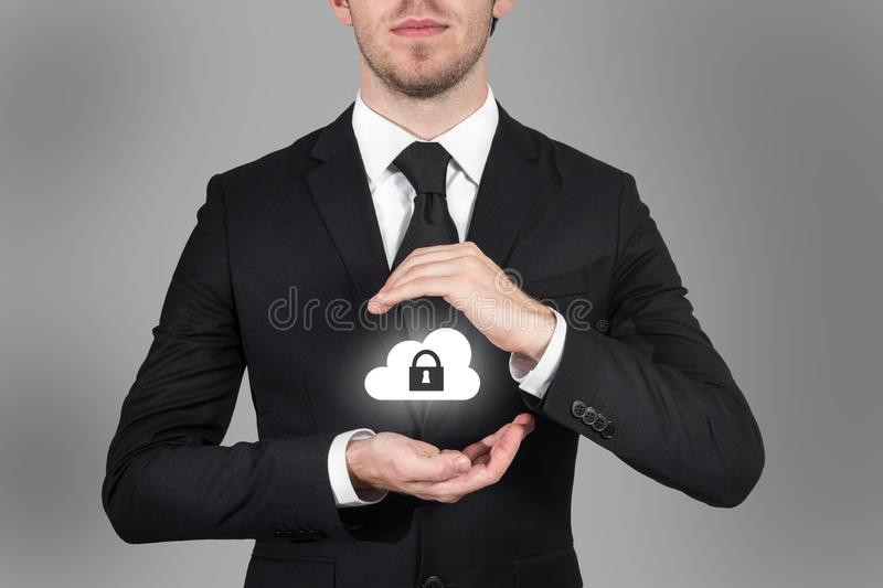 Businessman protects cloud data symbol with his hands malware royalty free stock photography