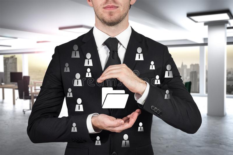Businessman protects folder data symbol with his hands malware royalty free stock photo