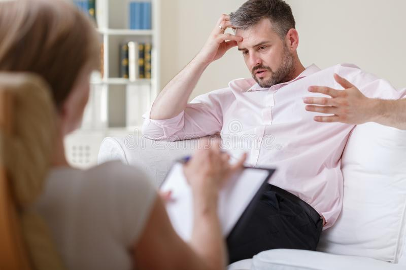 Businessman on psychotherapy session royalty free stock photo