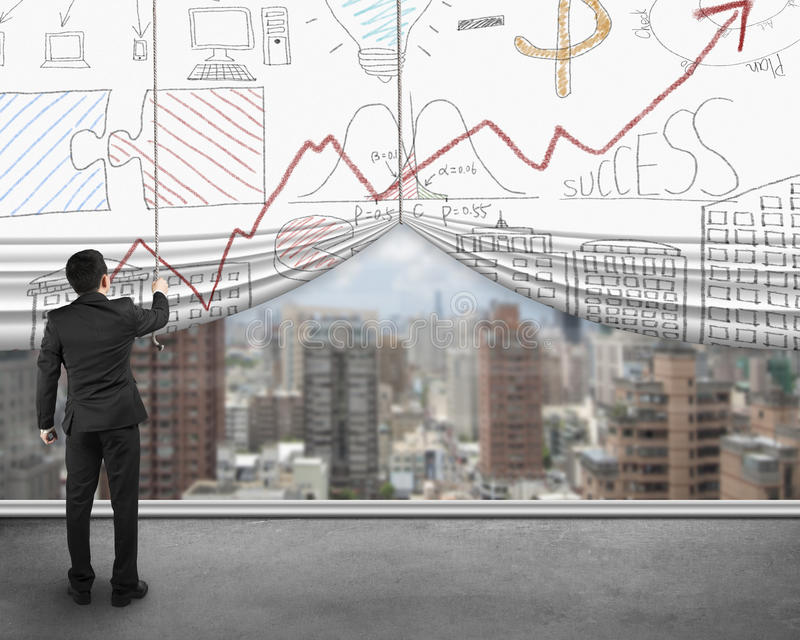 Businessman pulling open business doodles curtain with view city. Businessman pulling open business doodles curtain with view of city buildings, standing on stock image