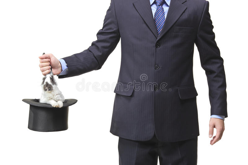 Businessman pulling a rabbit out royalty free stock photo