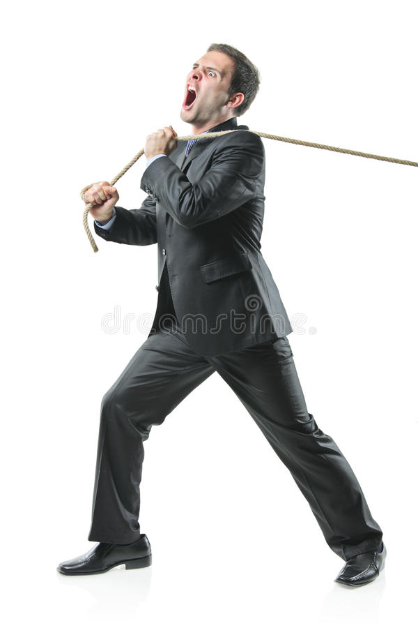 Businessman pulling a rope royalty free stock images